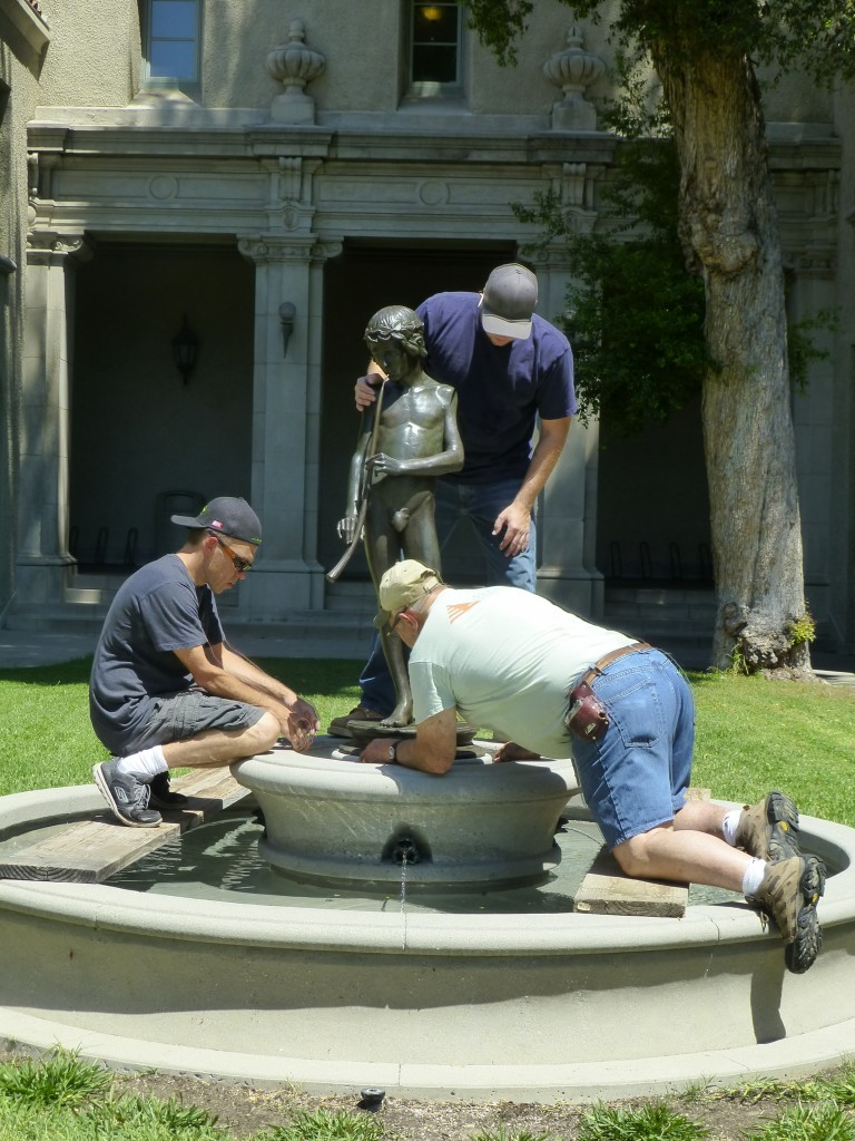 McEachron Construction and Design Team installing statue--Gabe Senica, Mike McEachron (kneeling) and Justin Kelly